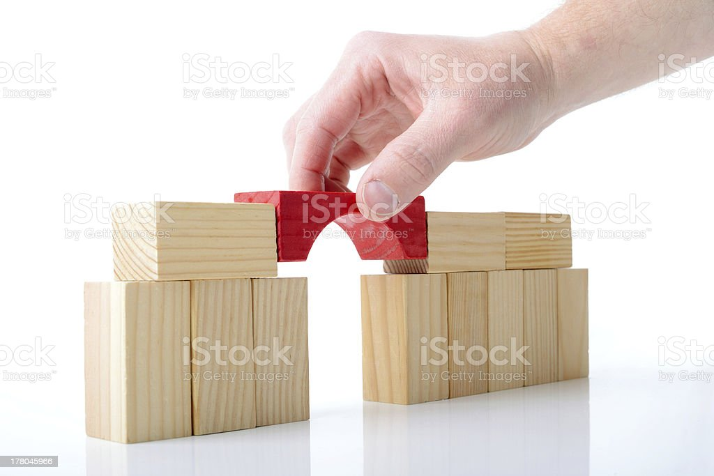 Hand finishing block bridge with red block royalty-free stock photo