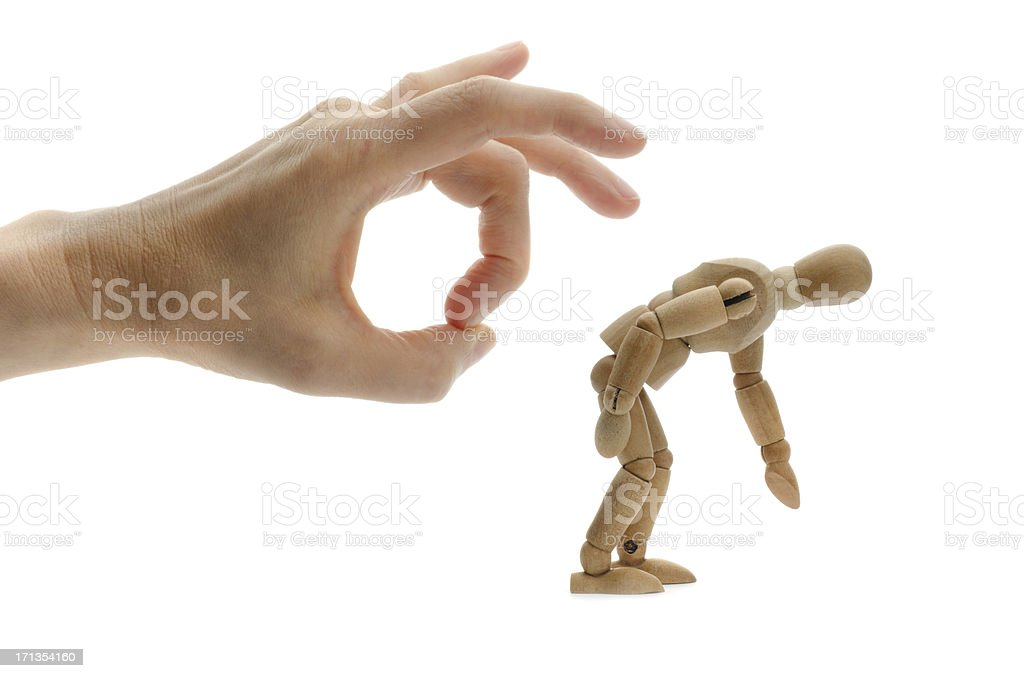Hand flipping wooden mannequin stock photo