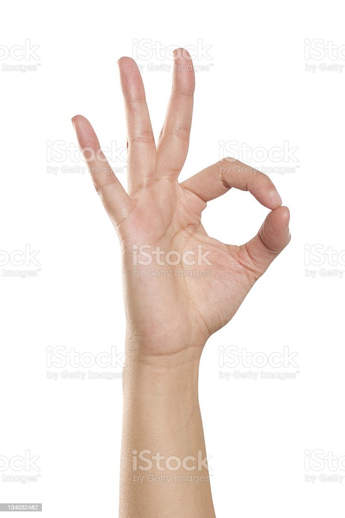 Hand forming OK sign stock photo
