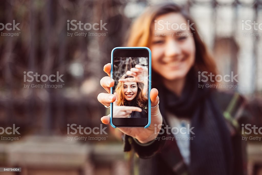 Hand frame concept with smartphone stock photo