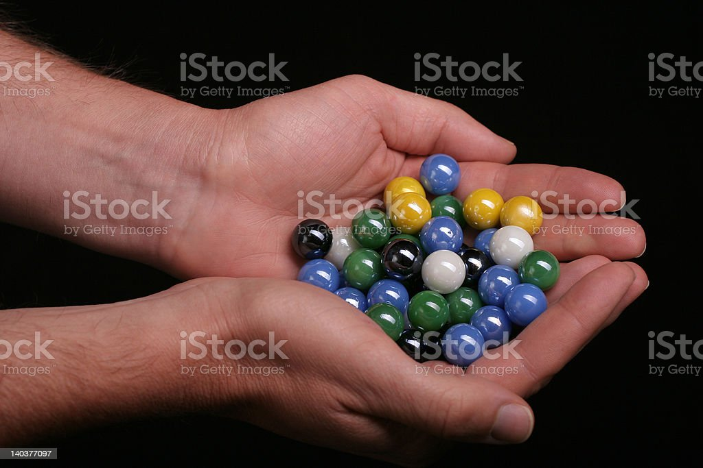 Hand full of marbles stock photo