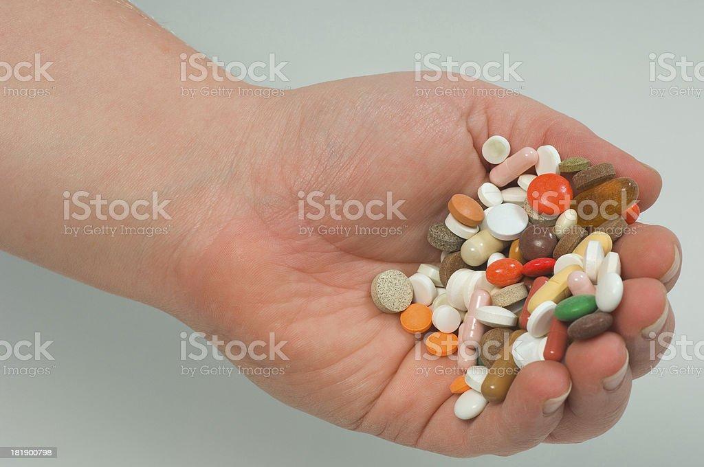hand full of pills stock photo