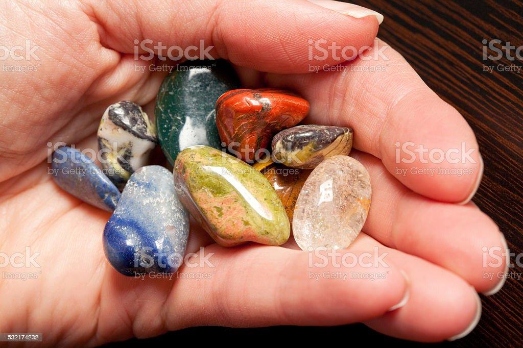 Hand Full Of Precious Stones stock photo
