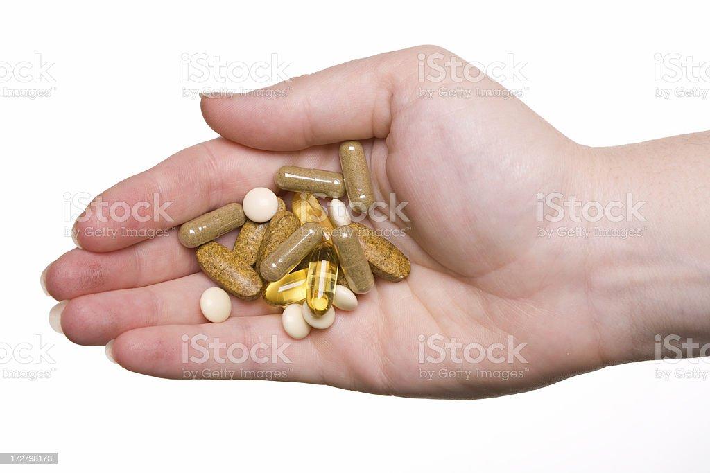 hand full of vitamins stock photo