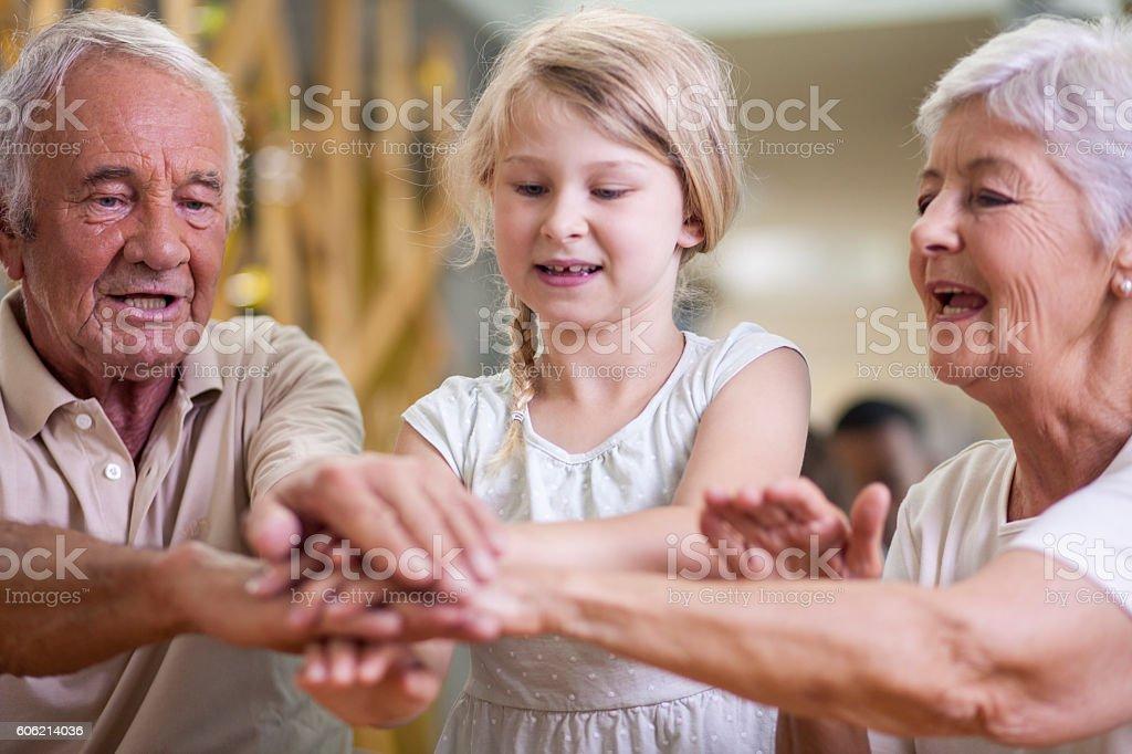 Hand games - seniors and grandchildren stock photo