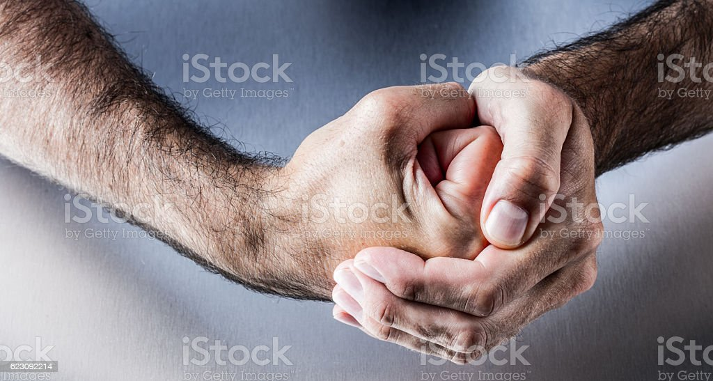 hand gesture for symbol of courage, power, union or impatience stock photo