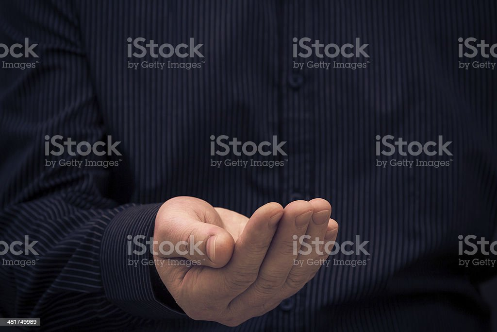 Hand gesture holding ask help royalty-free stock photo