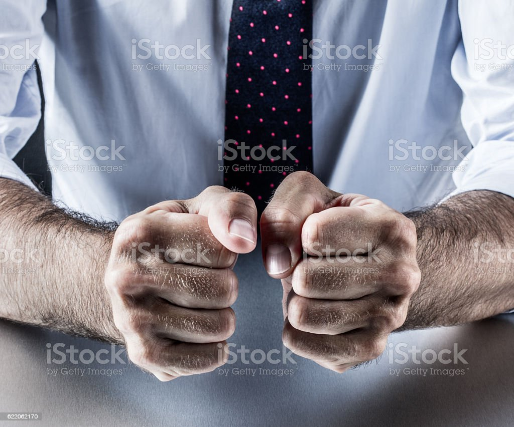 hand gesture, symbol of courage, power, conviction, union or impatience stock photo