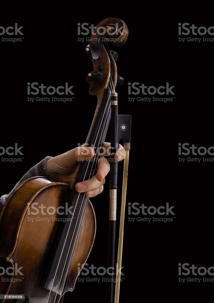 Hand girl holding a violin stock photo