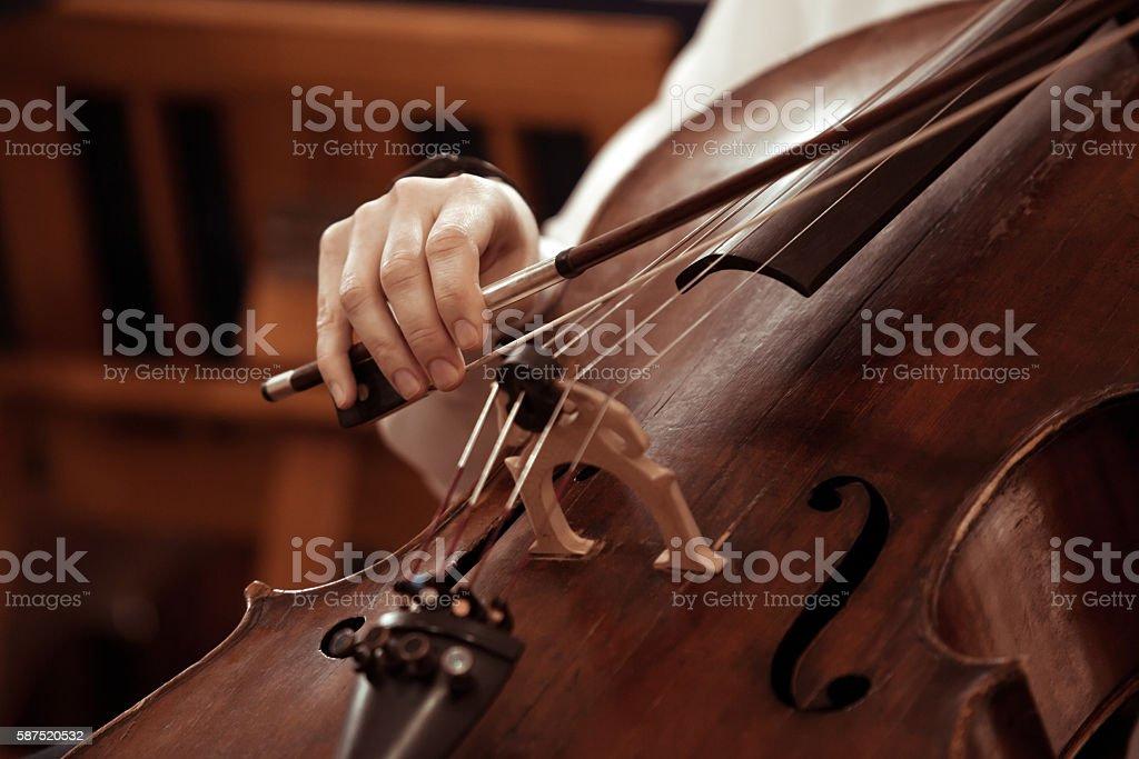 Hand girl playing cello closeup stock photo
