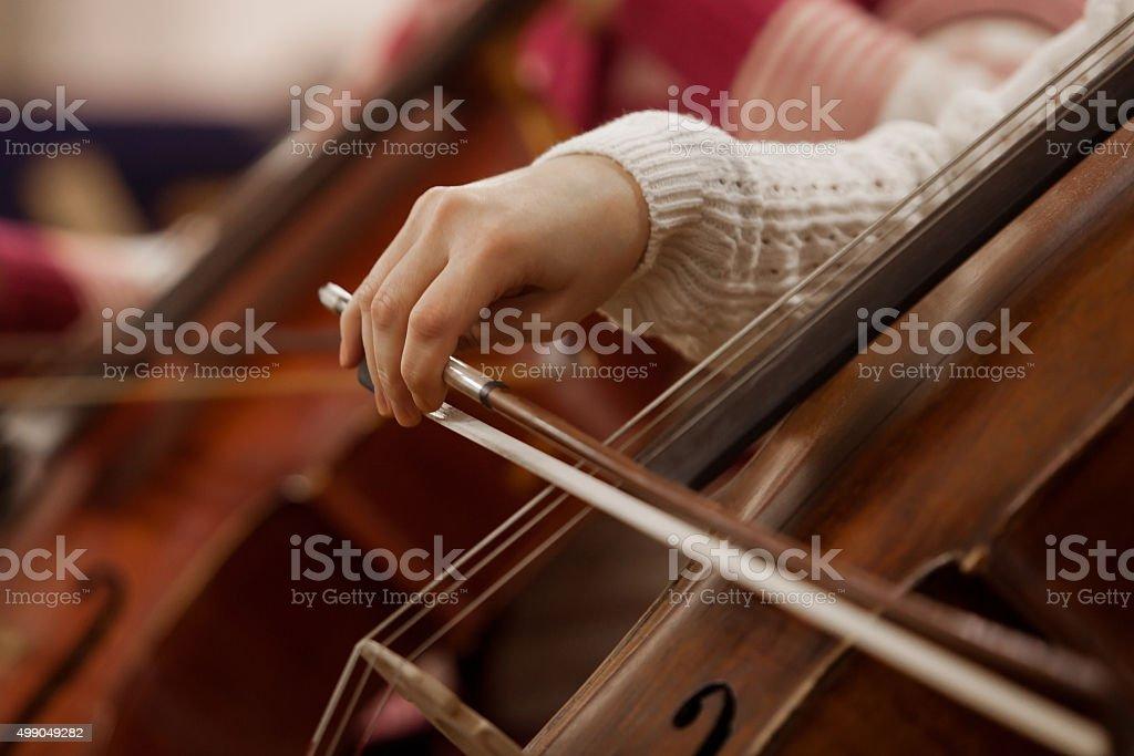Hand girl playing cello stock photo