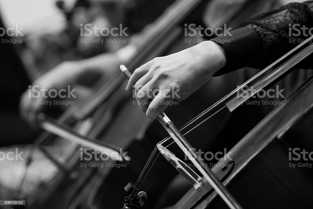 Hand girl playing the cello closeup stock photo