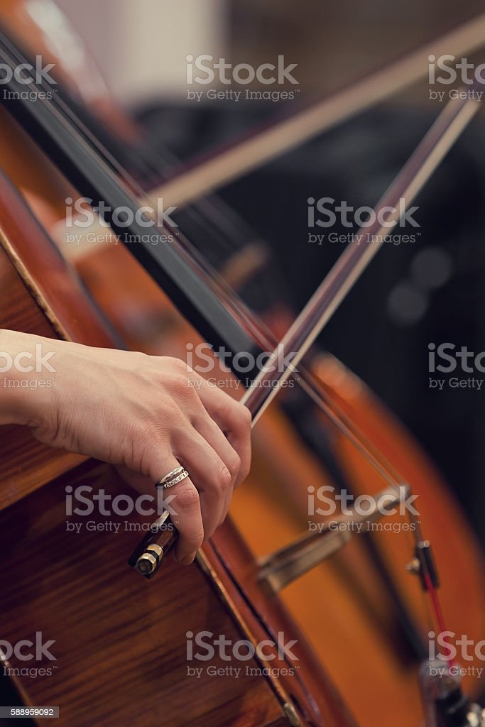 Hand girl playing the cello stock photo