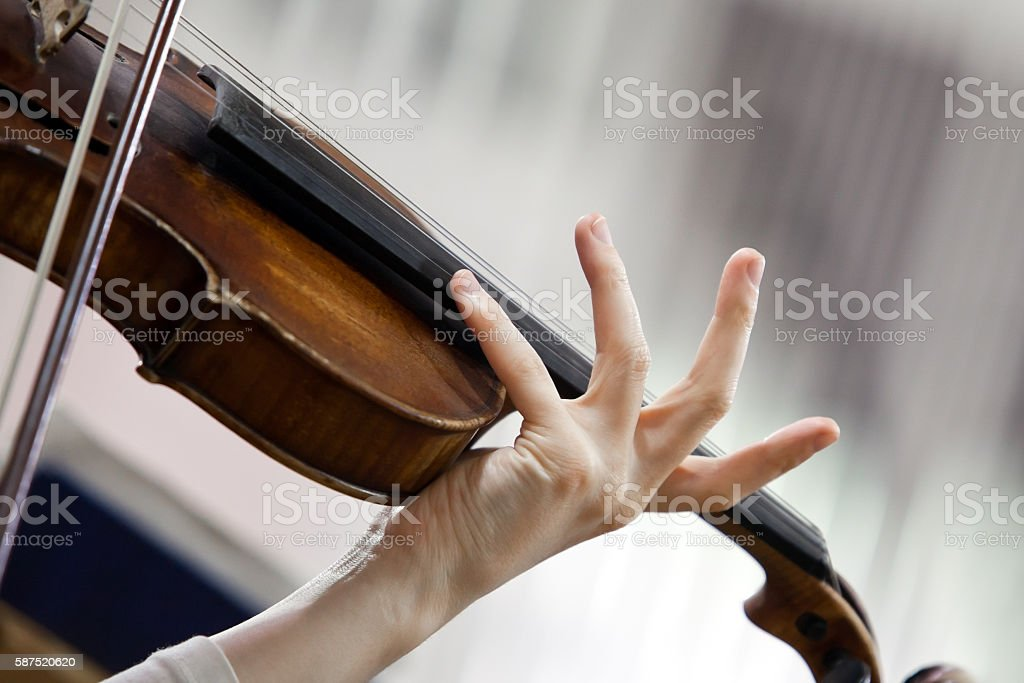 Hand girl playing the violin stock photo