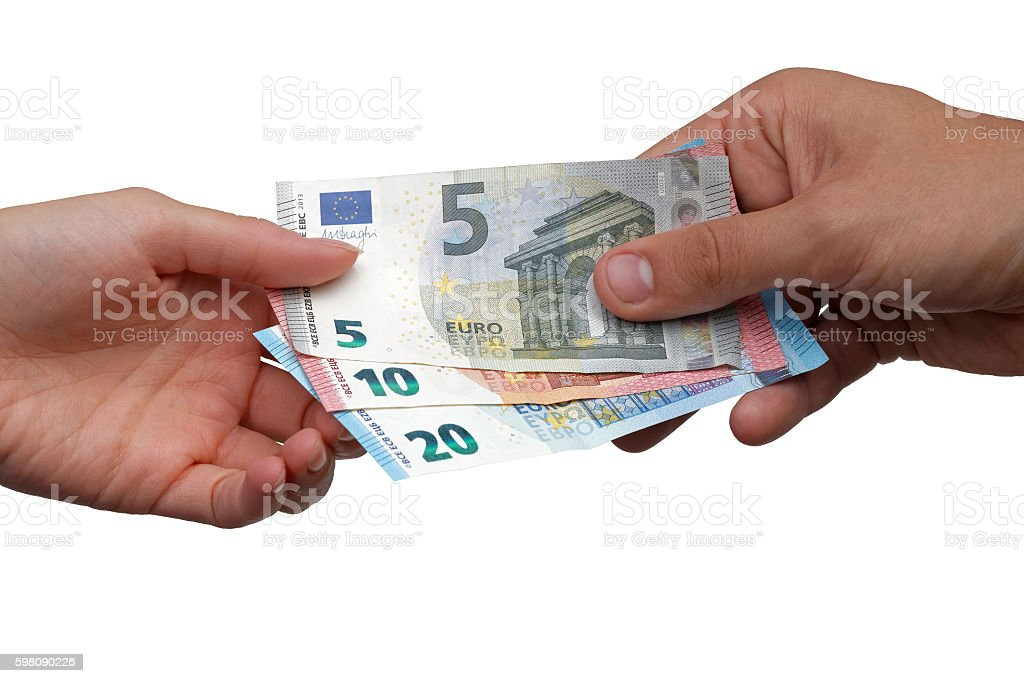 Hand giving Euro banknotes to another hand stock photo