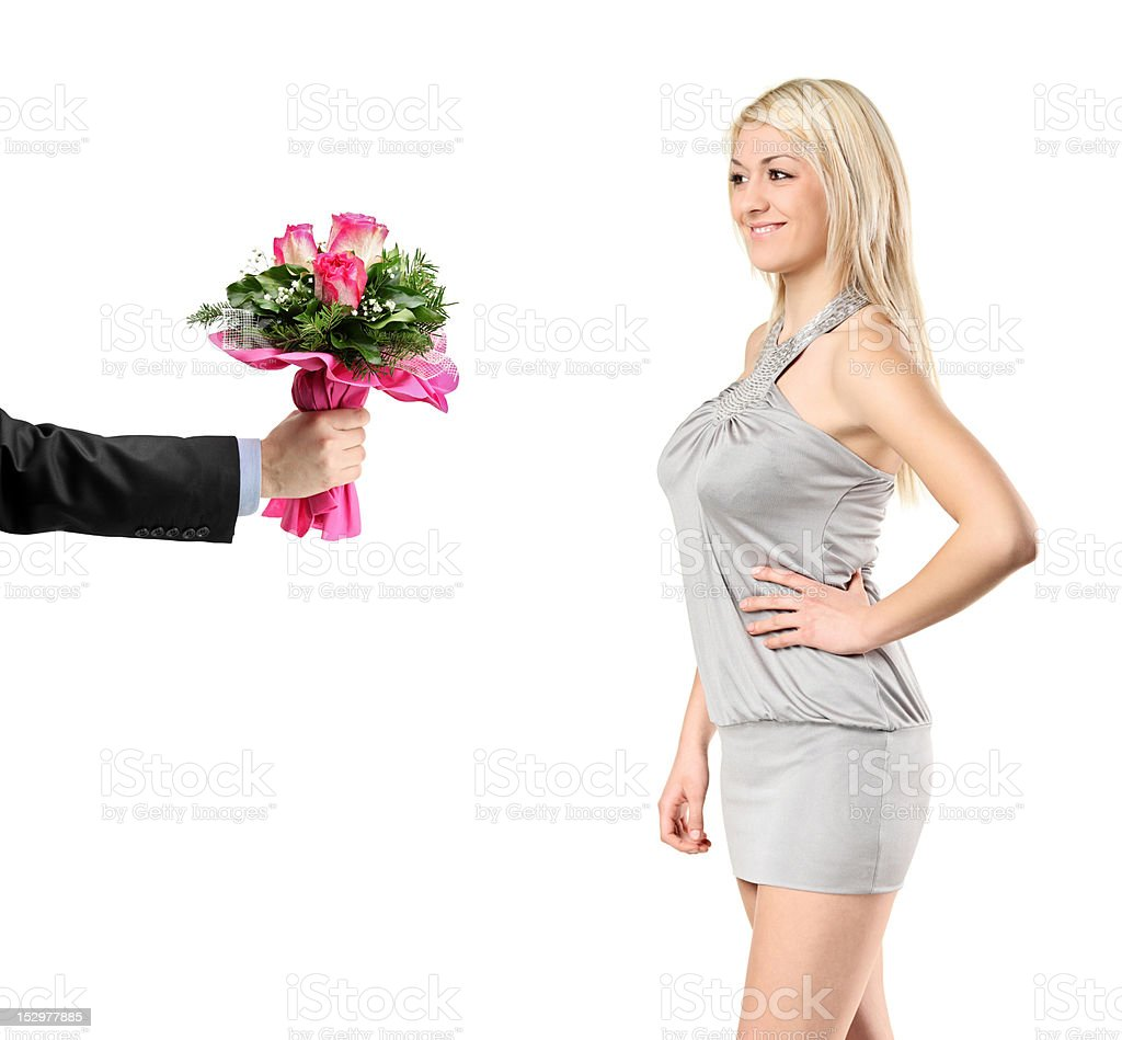 Hand giving flowers to a sexy woman royalty-free stock photo
