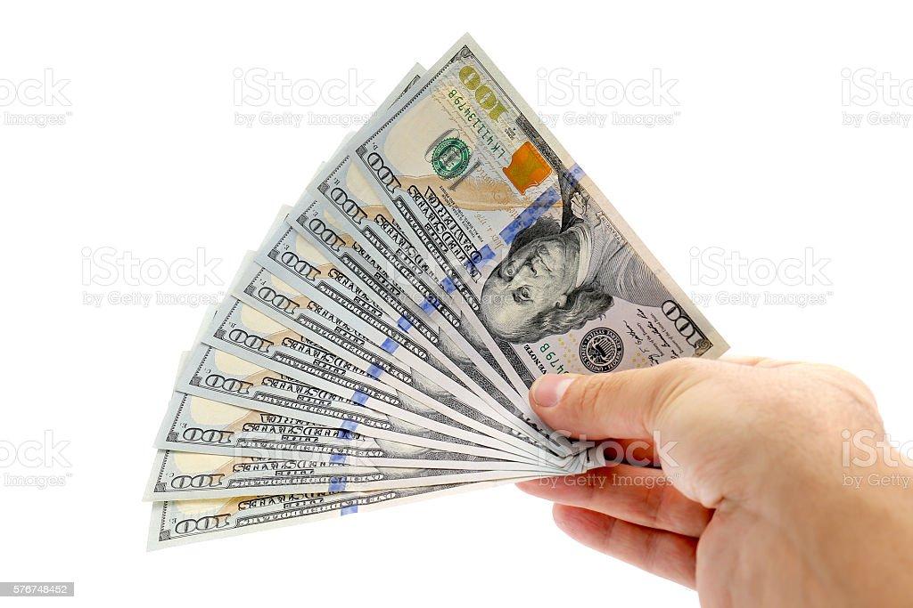 hand giving hundred dollar bills stock photo