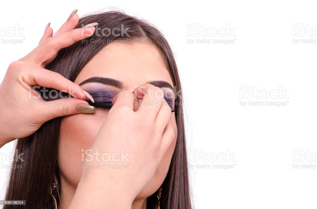 hand glued eyelashes on a model or a girl stock photo