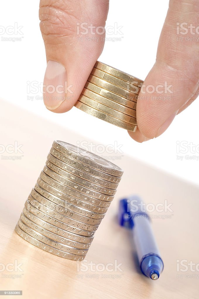 Hand grabbng stack of Euros royalty-free stock photo