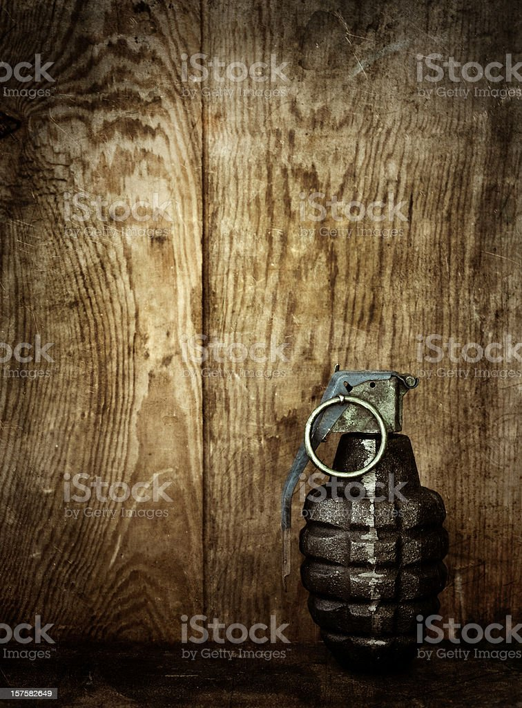 hand grenade on wooden background stock photo
