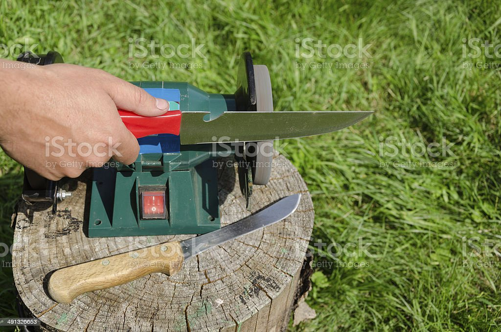 Hand grinder knife with electric tool stock photo
