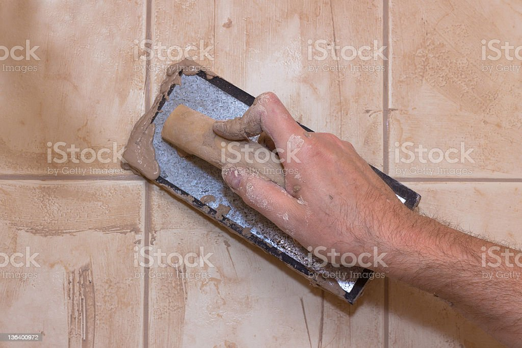 Hand Grouting Tile stock photo