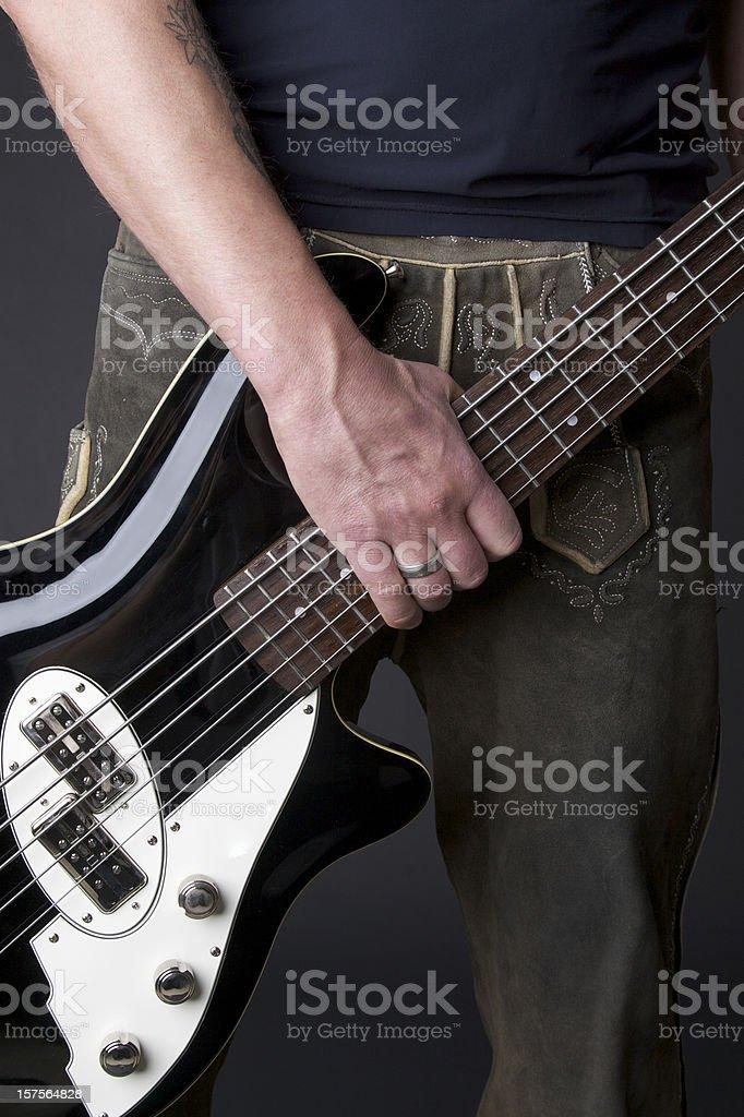 Hand, Guitar and Lederhosen stock photo