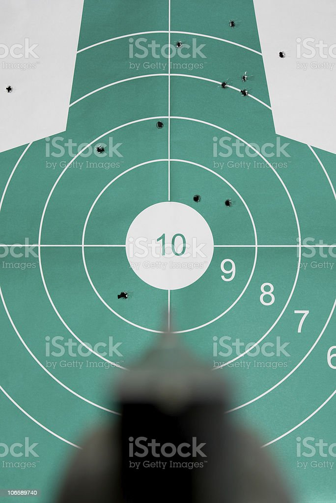 Hand gun aim straight at target royalty-free stock photo