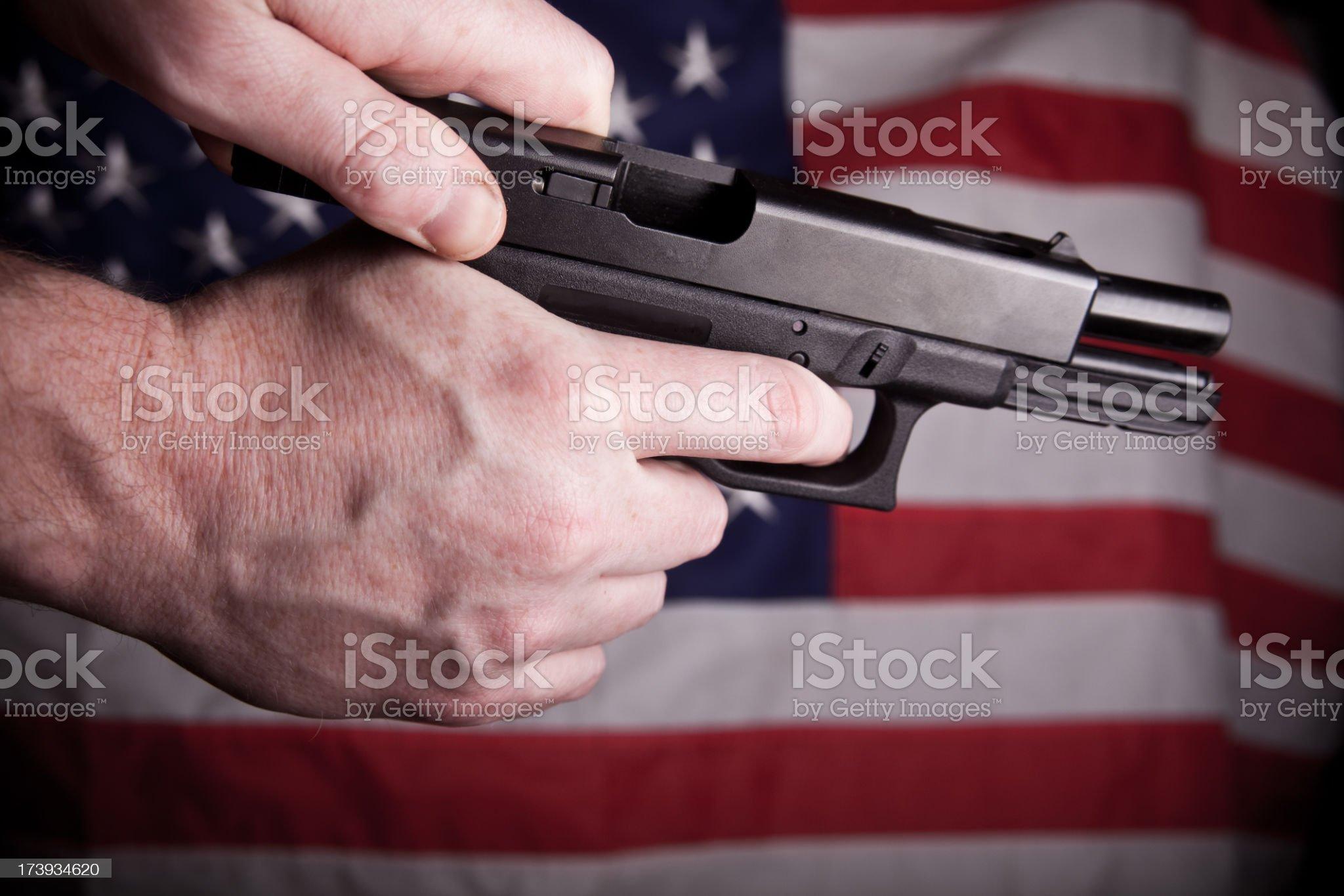 Hand, gun and American flag royalty-free stock photo