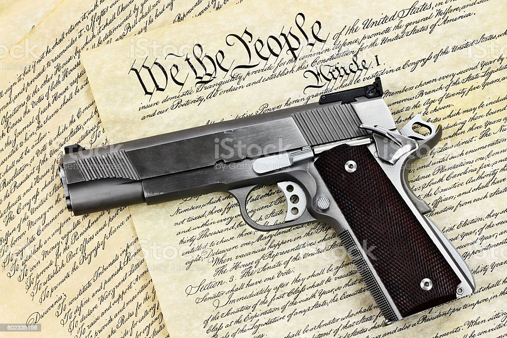 Hand Gun and Constitution stock photo