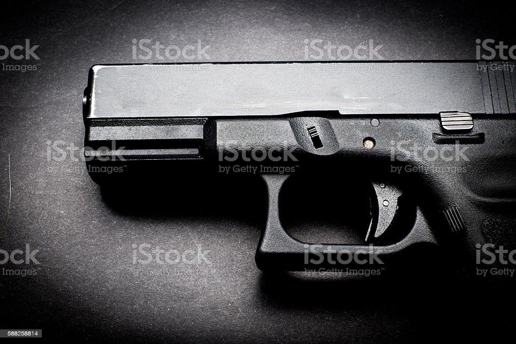 hand gun on black background stock photo