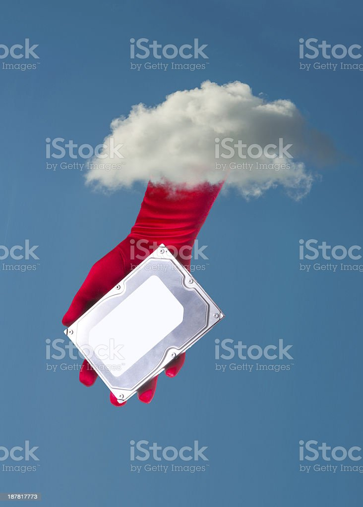 hand handing a large hard disk from the cloud stock photo