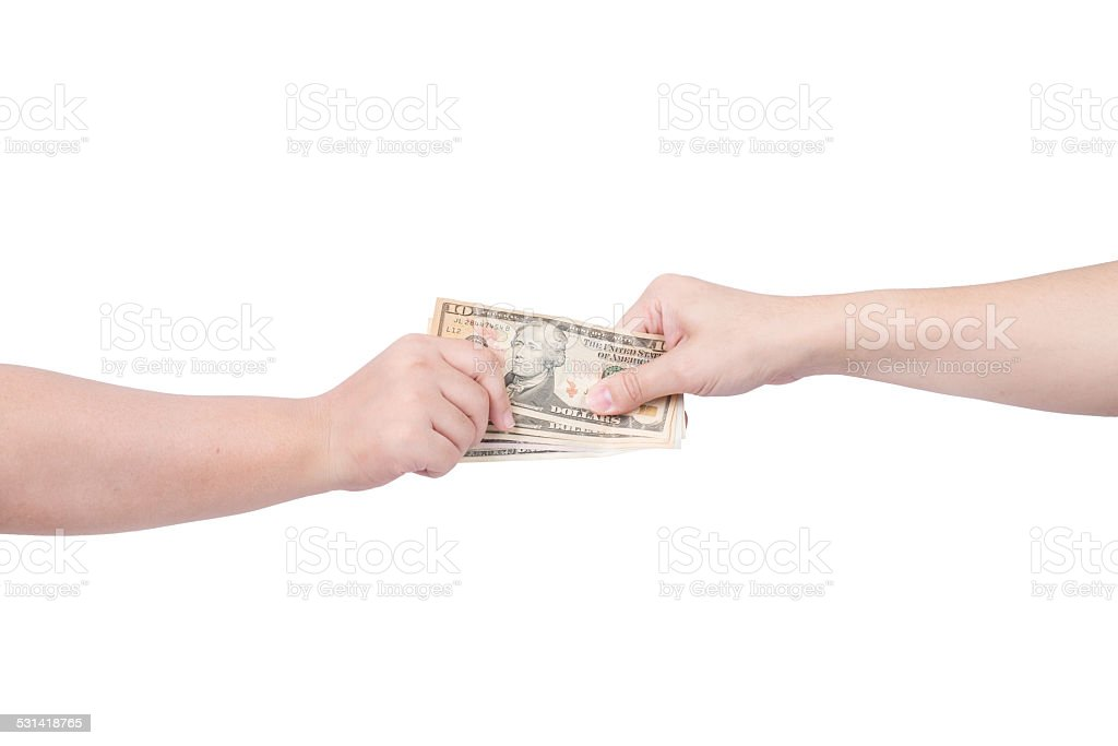 Hand handing over money to another hand isolated on white stock photo