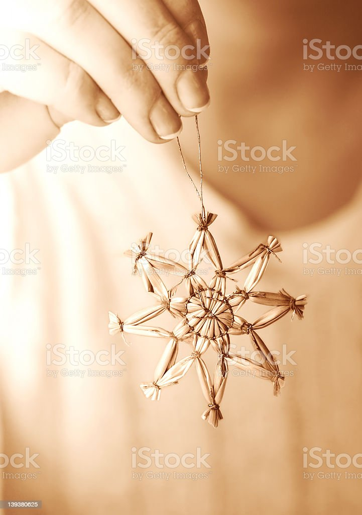 Hand Hanging Star Ornament royalty-free stock photo