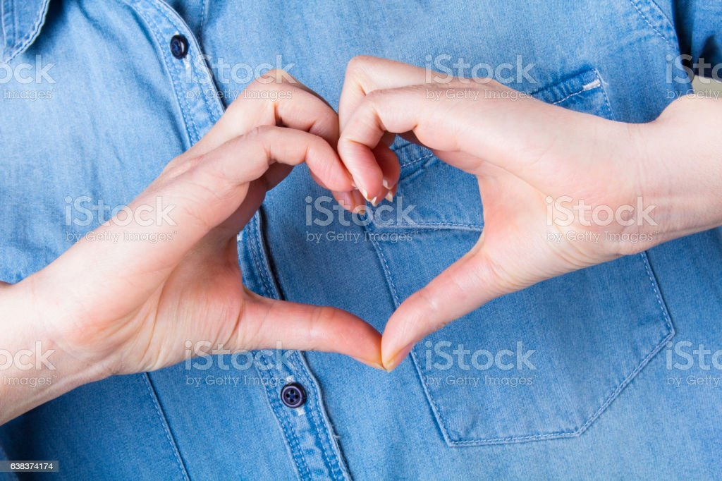 hand heart gesture love concept blue jeans stock photo