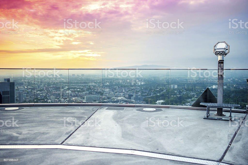 hand held Binoculars or telescope on top of skyscraper stock photo