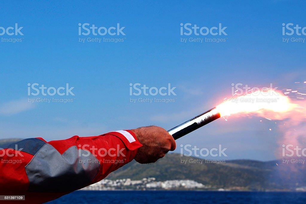 Hand held distress flares stock photo