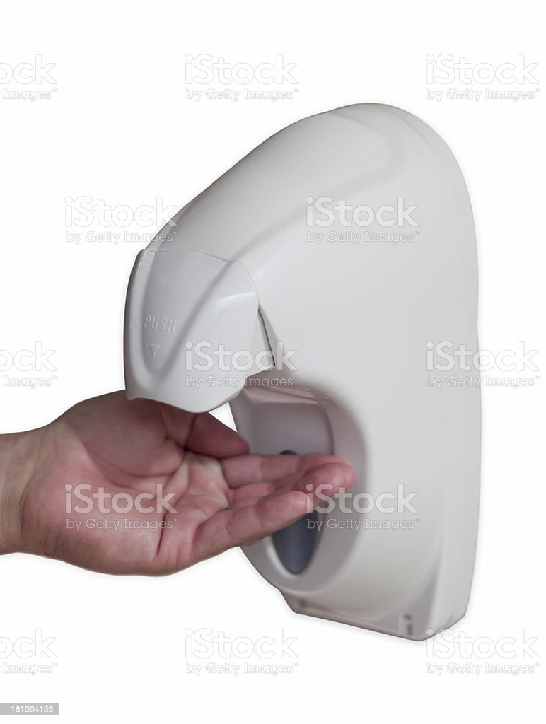 A hand held out under a hand sanitizer dispenser stock photo