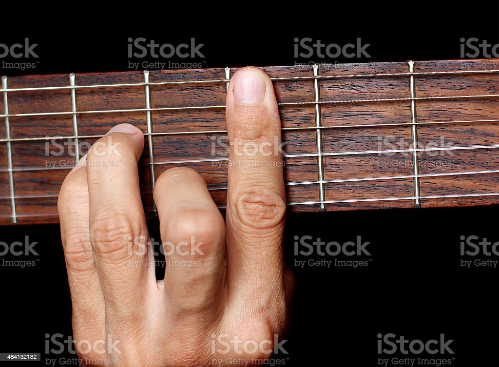 hand, hold a chord on the guitar fretboard stock photo