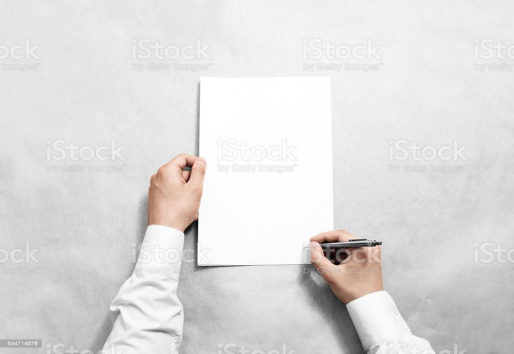 Hand hold blank contract mockup and signing it stock photo