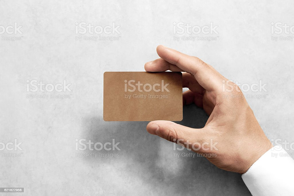 Hand hold blank craft card mockup with rounded corners. stock photo