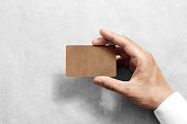 Hand hold blank craft card mockup with rounded corners.