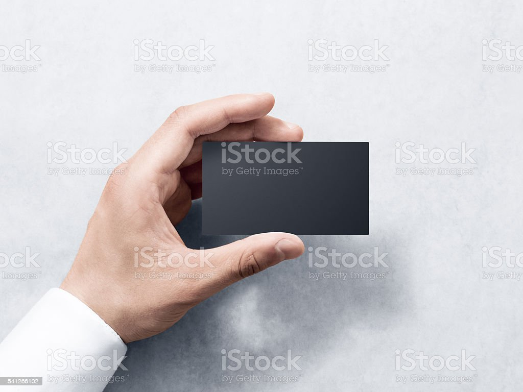 Hand hold blank plain black business card design mockup. stock photo