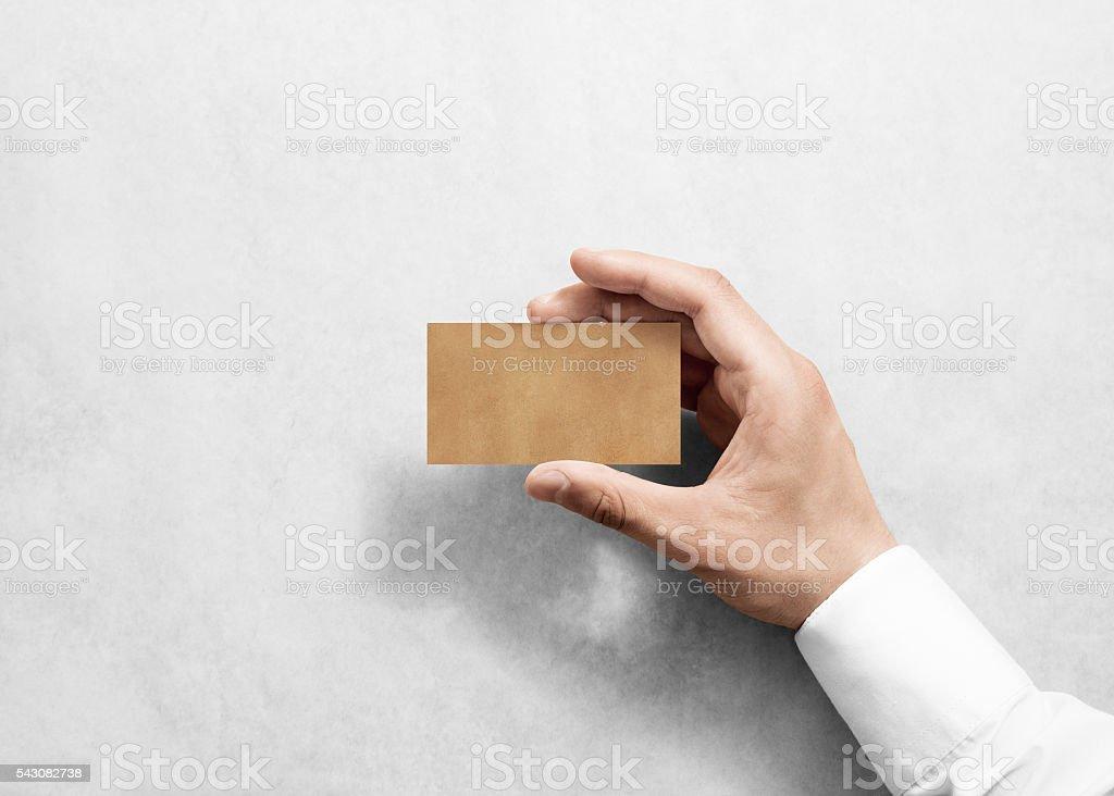 Hand hold blank plain craft business card design mockup. stock photo