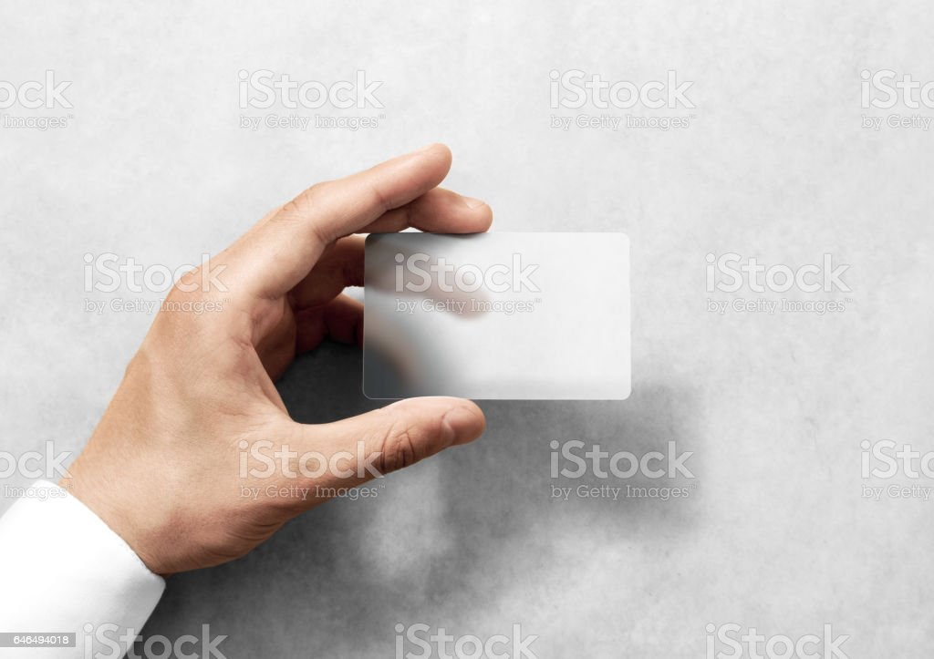 Hand hold blank translucent card mockup with rounded corners stock photo