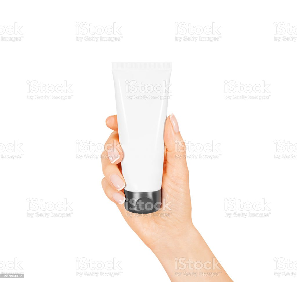 Hand hold blank white tube mock up isolated. Empty cream stock photo