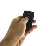 Hand hold Car key with remote buttons on white background