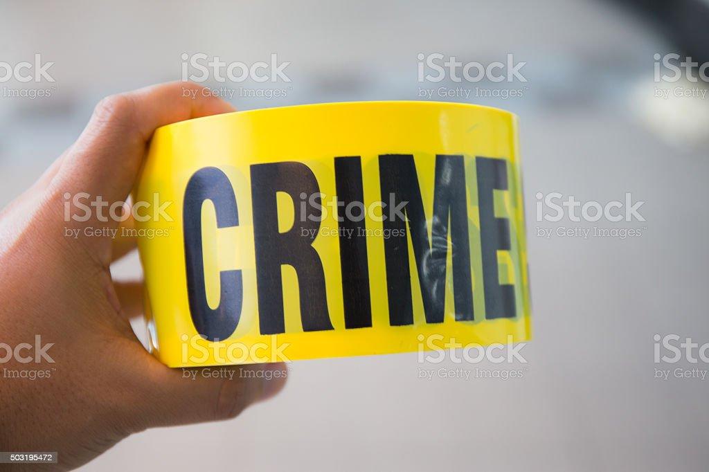 hand hold  crime scene tape stock photo