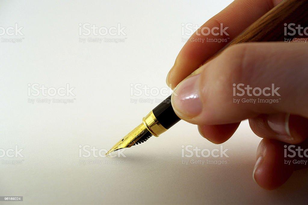 Hand hold fountain pen stock photo