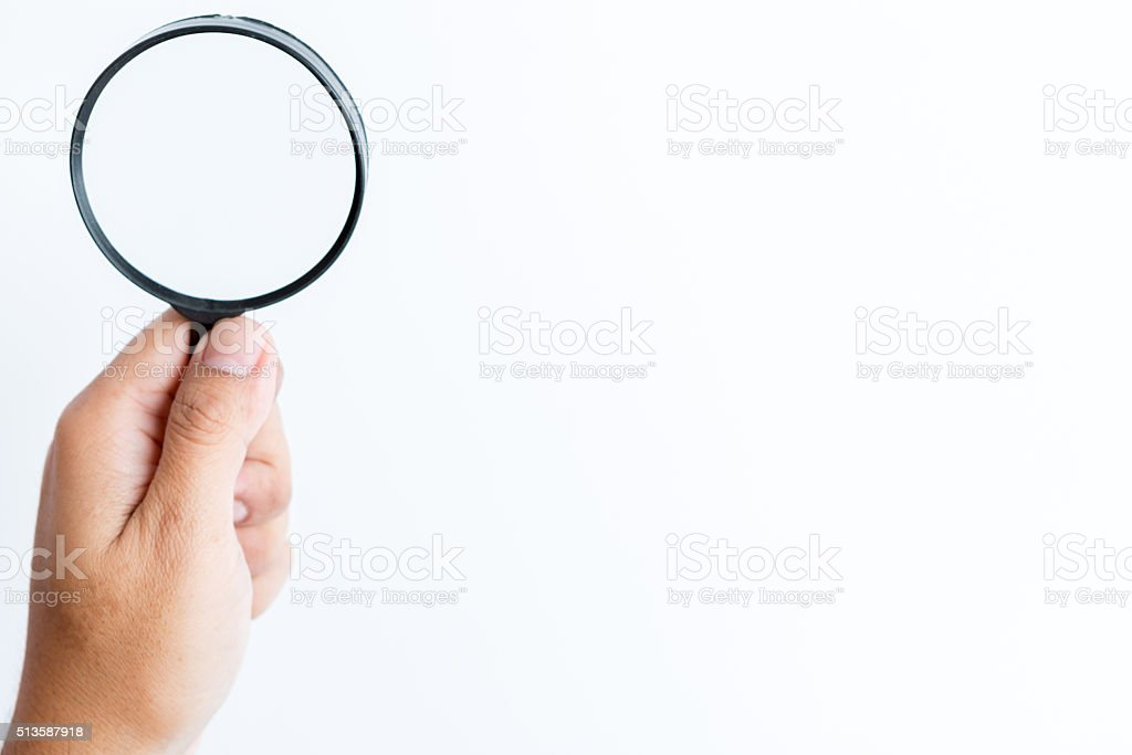 Hand hold Magnifier to search stock photo